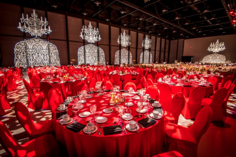 Event decor and gobo lighting on walls at corporate employee gala in Calgary photography by Leblond Studio
