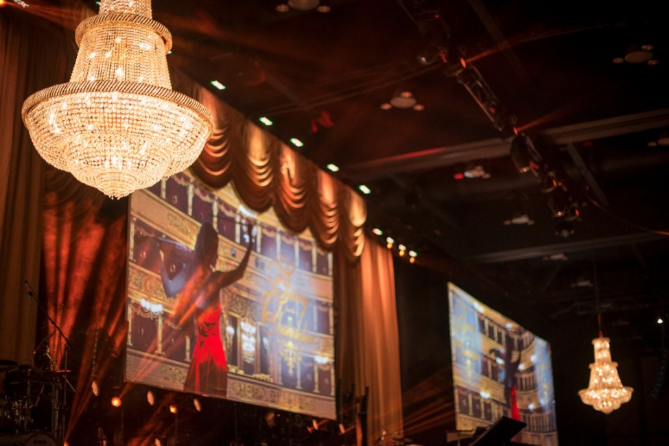 Event decor and stage lighting on walls at corporate employee gala in Calgary photography by Leblond Studio