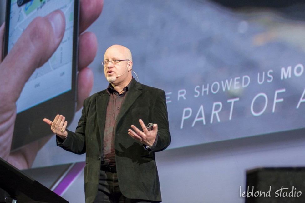 Photo of speaker on stage from Catalyst Leadership Conference in Calgary