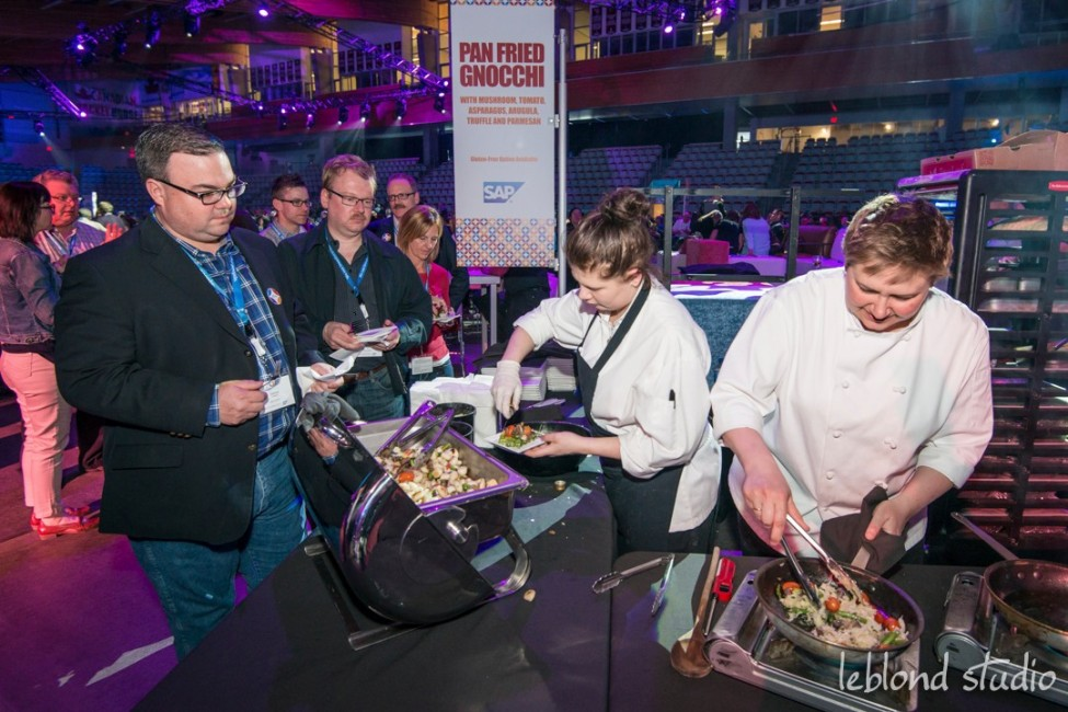 Event photo of guests at food stations from Catalyst Leadership Conference in Calgary